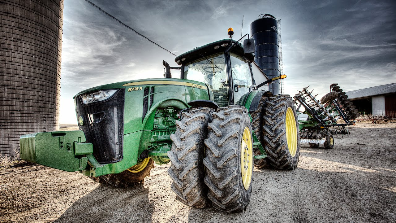 Modern tractors, like this John Deere 8235 R, contain sophisticated hardware and software. But farmers are finding that a 1990s era copyright protection law prevents them from repairing them when they break.